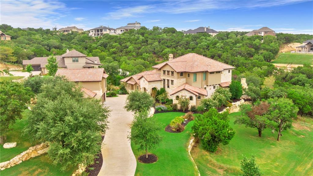"""Stunning 6338 SF home in Grand Mesa at Crystal Falls.  This beautiful home sits on 1.6 acres with incredible hill country views and features 5 bedrooms, 6 full baths and 2 half baths.  The incredible outdoor space won the award for Best Outdoor Living from the HBA of Austin.  It features a fabulous pool with a huge hot tub, outdoor kitchen, outdoor dining area with fireplace, a separate fire pit, large covered living space, upper covered balcony with glass rails and wonderful outdoor lighting for ambience.  The hill country views from the patio are stunning!  The spacious owner's retreat includes private access to the covered patio and features a luxurious en-suite marble bathroom complete with rain shower, wall sprayers, heated towel rack and TV niche.  The gorgeous custom kitchen boasts a 6 burner Wolf range, Sub-Zero refrigerator, Scotsman ice maker,  large island with seating,  built-in desk and coffered ceilings.  The dining room sits adjacent to the kitchen and is an ideal entertaining space, featuring wood ceiling beams, a storage/serving alcove with custom cabinetry and a wine fridge.  The spacious main living room includes high ceilings with beautiful wood beams, a 48"""" Isokern fireplace and 3 sets of French doors leading out to the covered patio, creating the perfect opportunity for indoor/outdoor living.  The stunning brick-accented wine room is temperature-controlled and offers custom space for 800 bottles! The upstairs study includes a wet bar, private bathroom and private balcony.  It is a fantastic space and could also serve as a game room, workout room, or media room.  The spacious 4-car detached garage includes a private upstairs apartment complete with bedroom, living room and kitchenette.  This private space is perfect for multigenerational living, long-term guests or older children.  It could even be used as a home office, workshop, music studio, etc.  Each spacious guest room has its own walk-in closet and bathroom- perfect for guests or kids."""