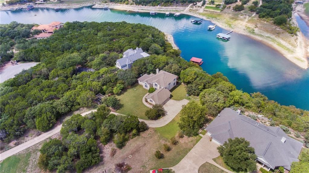 Check out this beautiful home on Lake Travis! This home has a great open floor plan and offers an abundance of natural light. Enjoy your morning coffee/tea outside on the deck or balcony and relax while soaking in the view of the lake and gorgeous scenery. Private dock for all of your outdoor water activities!