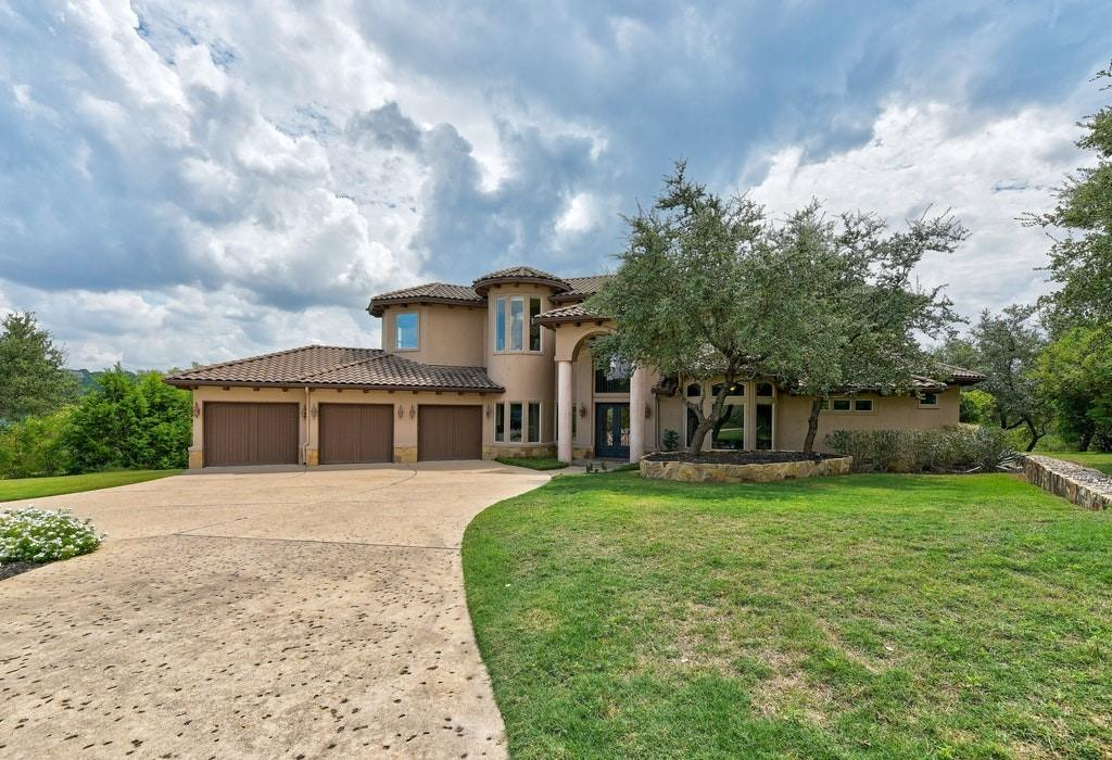 Beautiful spacious custom home in gated Angel Pass community with convenient access to AISD or private schools. Master bedroom/nursery, kitchen, guest suite and dining on main level. Large living area with wet bar in between 3 more bedrooms and 2 gorgeous bathrooms on second story. Smart home automation allows customization of the home environment including lights, temperature, music, and security. Private 1 acre lot with beautiful view of hills. 3 car garage with private driveway and additional RV or 2 parking space across from the driveway.  Open high ceiling floorplan with arch design throughout the house. Unique wall texture, recessed lights, pillars, spiral staircase, and rustic kitchen design.  Come see this gorgeous house!!
