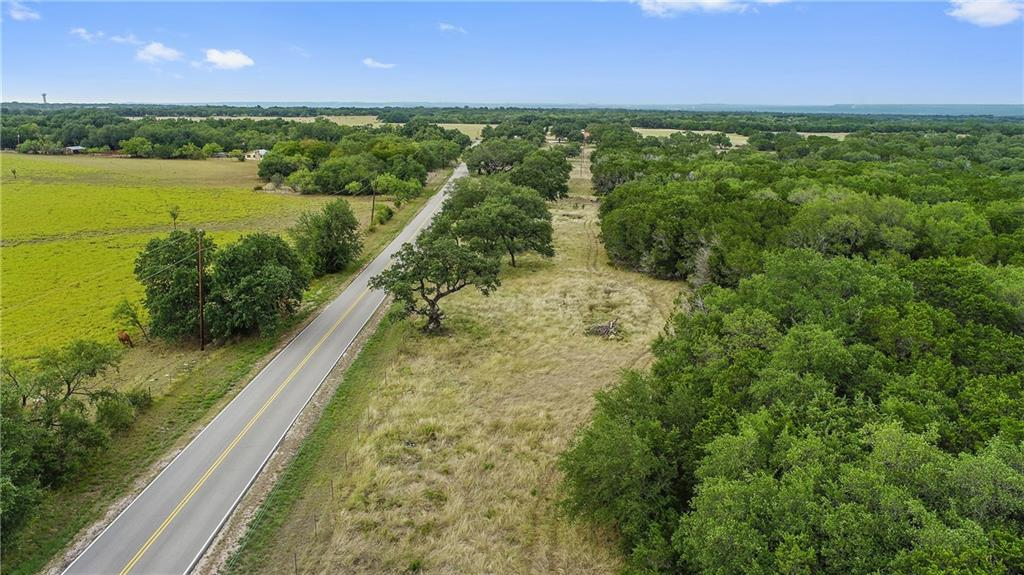 LOCATION  LOCATION!!!!  20 Acres Located Minutes from Marble Falls and a short drive to Austin. This property is a very usable tract and would make a great place to build a home.  The oak trees on site are fabulous. Some of the cedar has been removed. This property has great access with approx. 1140 ft of frontage on paved CR 401. The property is currently fenced on 3 sides. Light restrictions will be placed on the property including no manufactured homes, no RV parks, and it can only be subdivided into (2) 10 acre tracts.