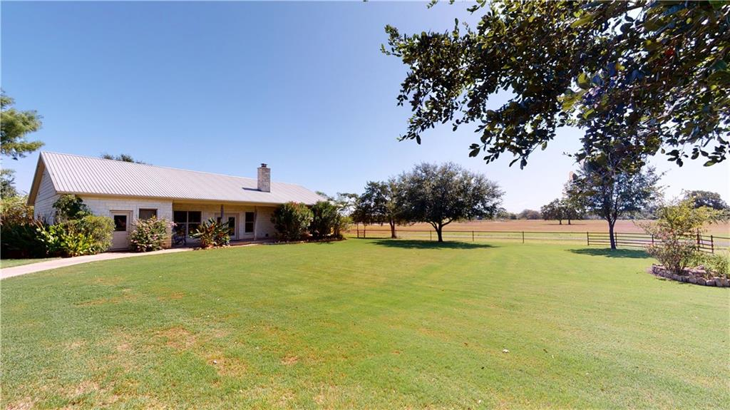 Gorgeous 2576 sf home on 103+/- ac w/125x100 sf show barn, 2 car carport w/shop w/in 5 min from town. Home inc 3 BR, 2 1/2 BA, office w/built-ins, media room, open concept living/dining/kitchen, walk-in pantry, rock fireplace, concrete countertops & floors, utility/laundry room, 10 ft ceilings, recessed lighting, fans, attic storage & more. Master bath w/double vanity, doubled headed walk-in shower, large tub, & walk-in cedar closet w/built-ins. Carport/Shop inc he & she sheds w/AC & heat, workshop, storage, spray foam insulation, & more. Show barn w/3 pens inside, concrete perimeter for back half/washing area & hay, Lee Co. water & elec, exhaust fan & more. Spring fed creek, Pecan trees, 2 stocked ponds w/docks (1.5 acres has crappie & 2 acres catfish), pipe fencing & elec gate. Lee County water & drilled well, electricity & water to home, carport/shop & barn. Chicken coop & above ground pool. Minerals neg. Please see attachment for exclusions & MANY upgrades! Inc PID's 102306 & 98443