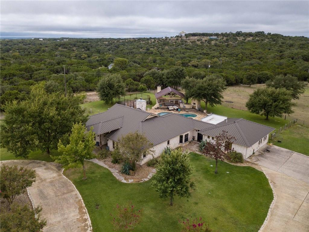 Perfect hill country retreat less than 20 mins to downtown Austin. Privacy, mature live oaks, views, full size 150x250 rodeo arena, livestock tank, pool, spa, outdoor pizza oven and 30x60 commercial workshop. This property consists of 3 separately deeded lots (1.17+1.0+9.83 acres) and cross fenced for horses and cattle. AG exemption. Dripping Springs ISD. Separate 9.83-acre tract with perfect, secluded building site, horse arena, stables and workshop available a la carte for $1M.