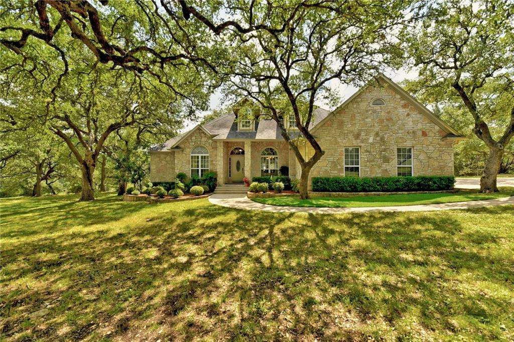 Most amazing opportunity for land and home at beautiful Ruby Ranch located west of Buda, TX!  So many mature trees on approx. 5.11 acres .  Even (2) horses are welcome!  Inside you will find open living spaces, an additional secondary bedroom with dedicated bathroom, a dedicated office for some who may work from home, soaring ceilings, granite counters at kitchen, built-in cabinet at breakfast room, spacious laundry room and an incredible view of the stunning covered back porch from the family room.  Large deck adjoins the covered back porch!  Make your way to the gazebo (has electricity) and then down the path to the oversized 3 car garage (approx. 25x40 AND Plumbed).  Doors are 8ft and fully decked attic!  Private well and septic.  Concrete driveways and paths.  Just spectacular!