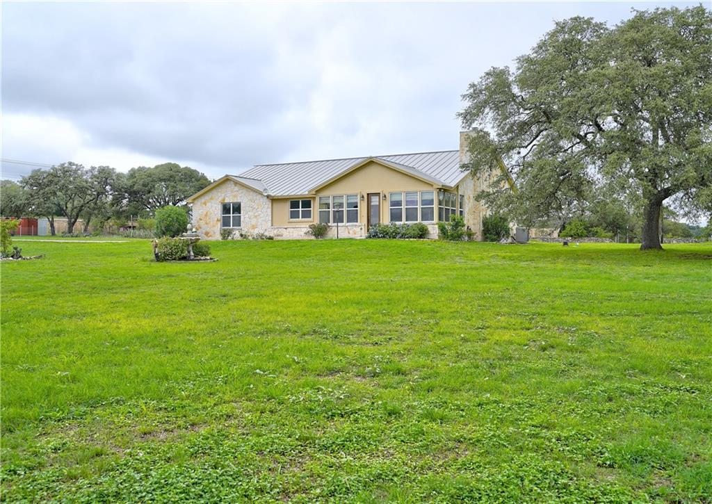 Great live/work property or mini-farm, or all 3!  House sits at the top of the hill.  Enjoy the sunset and hill country views from the sun room. So many possibilities for this property!  Just 4 miles west of downtown Dripping Springs.  Dripping Springs ISD.  2524sf house, 3 bed, 2 baths.  Huge, open concept kitchen, dining, great room with fireplace and tons of built ins.  Outbuildings suitable for horses, goats, chickens, corral and 3 small pastures.  Live/work, have your own mini-farm or just enjoy the tranquility of the country with easy access to HEB, Home Depot and restaurants.  Plenty of room to add vegetable gardens and other structures.  Minimal restrictions, commercial use permitted.