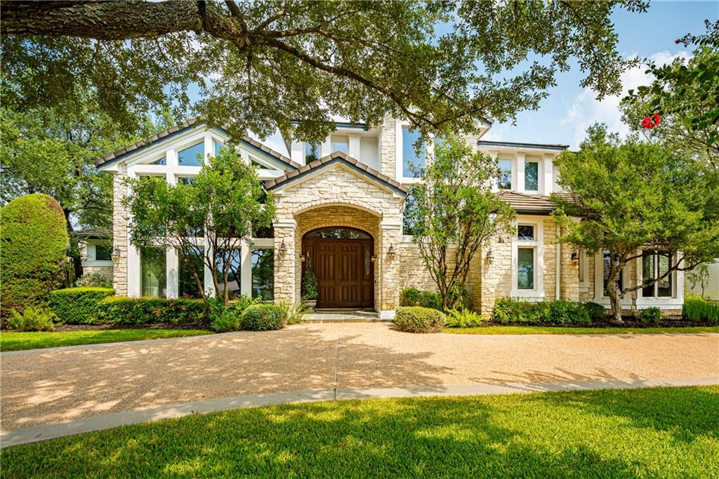 Sprawling custom estate on 3 tree-covered lots in The Hills of Lakeway. Texas limestone and clerestory windows with circular drive and an inviting & grand double door to welcome guests. Combining the best of classic style with contemporary convenience, the home features cathedral ceilings and a traditional floorplan with a fireplace-warmed formal living room and dining room flanking the entry foyer. An informal family room opens to the kitchen and covered porch. The spacious formal and informal rooms have beautiful windows providing natural light and flow well providing an open floor plan while affording just the right amount of privacy. The gourmet kitchen is complete with new custom inset cabinets, Miele appliances including an induction cooktop with grill, double ovens plus steamer oven, microwave, 3 dishwashers, and Subzero refrigerator.  This home is perfect for entertaining or family gatherings. The main level primary suite is complete with spa bath and walk-in closet with custom glass cabinetry. Three bedrooms on second level each have ensuite baths.  Also upstairs is a beautiful, wood paneled study and an oversized game and media room with wet bar. Large covered porches offer space to relax on both the 1st and 2nd floors of this lovely home. The expansive and lush back yard offers stately oak trees and open space for a pool.