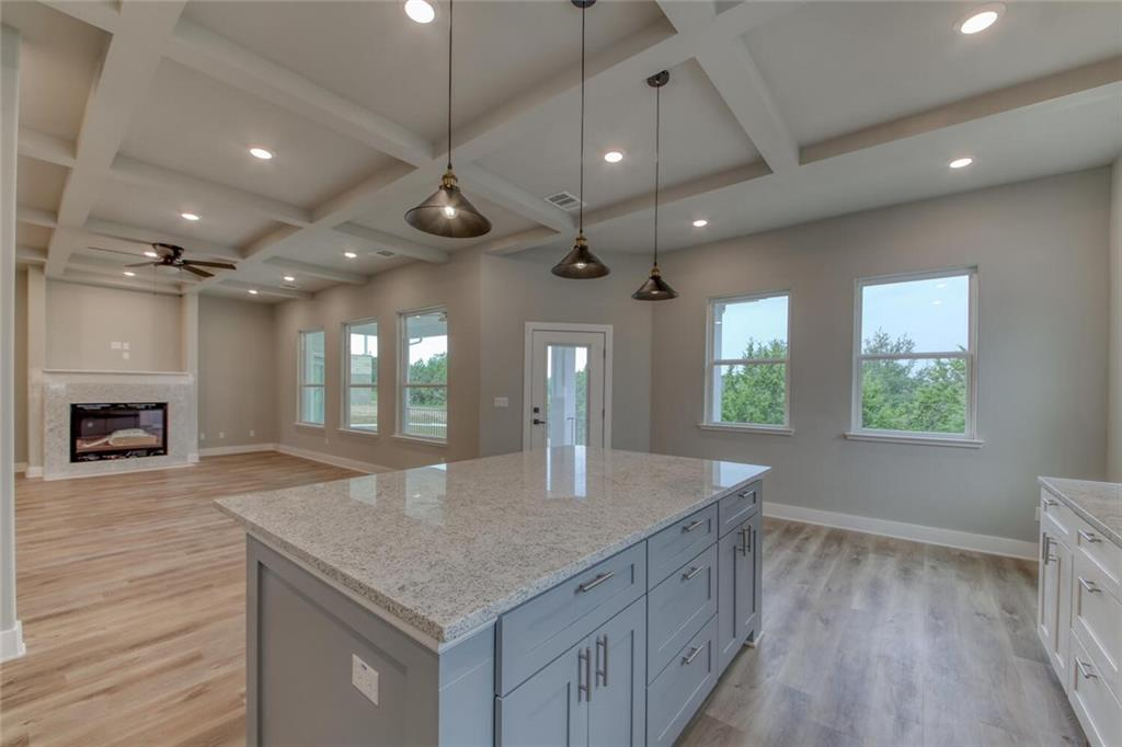 New construction close to the golf course.  This well thought out split floorplan houses everything needed on a single level.  An open floorplan is perfect for entertaining and gathering around the kitchen island. Fall is in the air...time to cozy up in front of the granite encased fireplace or enjoy the cool air on the huge covered back patio.  Off of the great room is an open dining room area and a dedicated office with french doors.  The primary bedroom suite is bright and airy with a beautiful free standing tub and separate walk-in shower and sleek fixtures.  A large double vanity and closet built-ins ensures theres a place for everything.  Tucked in the other side of the house are bedrooms 2 and 3, sharing a spacious and on-suit to both Jack-n-Jill bath with double vanity.  The oversized garage has 12' ceilings for plenty of hanging storage racks and opens into a large laundry/mudroom with built in bench and hooks.  Come make yourself at home!