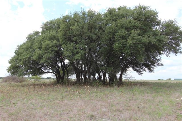 26+ acres just minutes outside of Liberty Hill!!  The property has a 60' wide flag which allows enough room to develop the property with a county approved road!  You will enjoy great views from the top of the property as well as a nice grouping of trees.  Very nice 24X50 storage building/workshop will convey along with the small office building at the gated entrance.  An electric gate at the entrance provides security.  The property will also come with additional chainlink fencing materials as well as the John Deere tractor/implements.  This is in Burnet CISD.