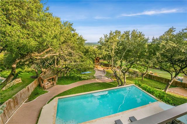 """Nestled in the rolling hills of Austin, you will see that the street is aptly named """"Big View"""".  Sitting on almost an acre in River Place, this tree dotted estate has loads of space to spread out and relax.   Three decks off the back to enjoy the stunning views.  Kitchen was made to entertain with double oven, two dishwashers, great counter space as well as storage.  Dedicated office is key in this day and age, and this one is a generous space just off the front entry.  Not only is she gorgeous but good bones too.....windows replaced last year and roof in 2015.  This is the one you have been waiting for!"""