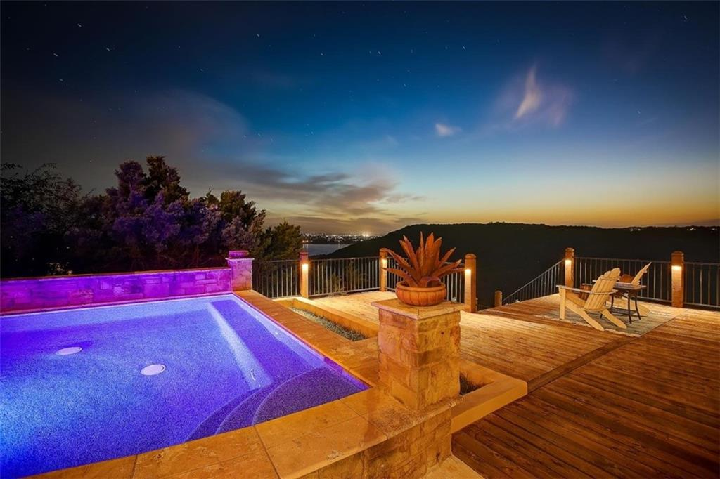 Beautifully positioned on one acre overlooking the gorgeous Lake Travis in upscale Villa Montana, this spectacular gated estate blends old world architecture with modern amenities to create a timeless abode. Truly a sight to behold with its unparalleled breathtaking views, spectacular sunsets, impeccable detailing, and fantastic living spaces designed to take in the enormous views of the hill country and lake. Built to the highest quality, the spacious open floor plan features a large expanse of glass, creative stonework, soaring ceilings and beautiful hardwood floors. The Chef's gourmet kitchen is spacious with a wrap-around serving bar, breakfast area and designer stainless steel appliances- all overlooking the two-story family room. All areas of the home flow seamlessly to the multiple patios and balconies for fantastic entertaining and true enjoyment of the lake and surrounding hill country. The master suite on main offers a luxury double-vanity bath, walk-in closet and many nights of stargazing from its private balcony. You will love spending time in your very private backyard with a beautiful spa and deck overlooking the vast canyon. With three well-appointed secondary bedrooms, wine room, dedicated study, large game room and media room, this home has everything you need to enjoy the tranquility of a luxury hill country lifestyle. This enchanting Austin retreat is in acclaimed Leander ISD. Check out the video tour: http://bit.ly/7208CieloAzulPassVideo