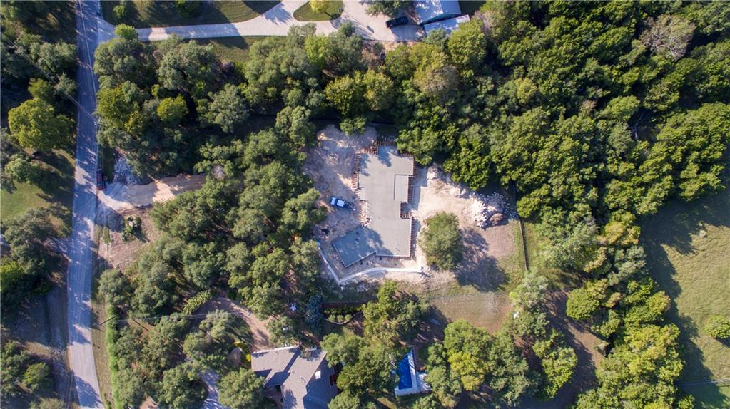 "Hill Country home being built by Strobel & Associates, Best in 'Houzz' 2018 & 2020 for Service!  Amazing 2.07 acres with a Hill Country setting, 'Cotton Wood Creek' running year round on the back of the property, & OAKS, LOTS OF OAKS!  One-story and a half story home with details you won't understand by staring at a floorplan, details like, vaulted ceilings & wood beams in the main living, owner's suite, & private study. Come SOON to pick out most of your design finishes or add a pool!  This home features a standing seam metal roof, spray foam insulation, engineered slab, engineered framing, quartz countertops, Fiberglass black interior & exterior Windsor® windows, custom 100% wood cabinets, fireplace surround that soars 18 feet to the ceiling with a wood beam and built in shelving on each side. Sunset Canyon offers light deed restrictions and zoned to the exemplary DSISD!  ESTIMATED COMPLETION IS IN MAY 2021!  **Please note that even exterior changes can be made at this point.  If you would rather have brick versus stone or stucco versus the ""Farmhouse"" look...."