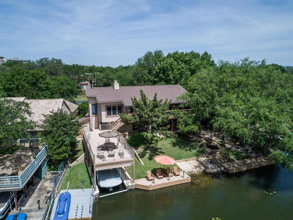 RARE FIND, remodeled Lake LBJ home in the Heart of Horseshoe Bay.  This is the Core Area with an easy walk or golf cart ride to the Yacht Club, Marina, Tennis facilities or Hotel. This beautifully remodeled Lake Home sits on one of the most handsome lots in the HSB core. A rock waterfall meanders from the lower covered porch to the edge of the lake. Large trees and lush landscaping with nice room for an  in-ground pool makes this the Ideal Lake Home for you and your family.  The Owner's Suite, with his and her's bath areas has private access to the upper level covered patio with serene views of the Lake and beautiful yard.  The upper deck gives a treetop feel for peaceful & relaxing gatherings.Come to Lake LBJ and Horseshoe Bay Resort...this home is ready and waiting on you.