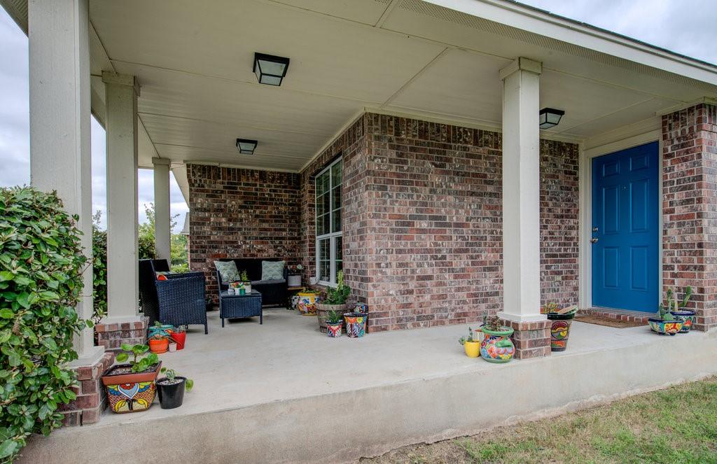 Perfect for investors, first-time buyers, or downsizing. This home offers an abundance of appealing features and a convenient location with easy access to Toll roads, Round Rock and Taylor. A spacious covered front porch welcomes you. Inside you will find a sizable living area with tall ceilings. The kitchen is open to the living room and offers granite countertops, an abundance of cabinetry, and a spacious eat-in dining area. The master bedroom is in the rear of the house for privacy. It offers space for a king-sized bed, plus additional furniture, and you will love the walk-in closet. The master bathroom features a double vanity, soaking tub, and separate shower. Also, there are two additional bedrooms with a shared bath and a large utility room. There are window treatments throughout, and no carpet. The backyard offers a wood privacy fence and a covered back patio. The lot is approximately .17 acres and backs to Cottonwood Creek elementary. Community pool and playscape close by, low HOA fees.