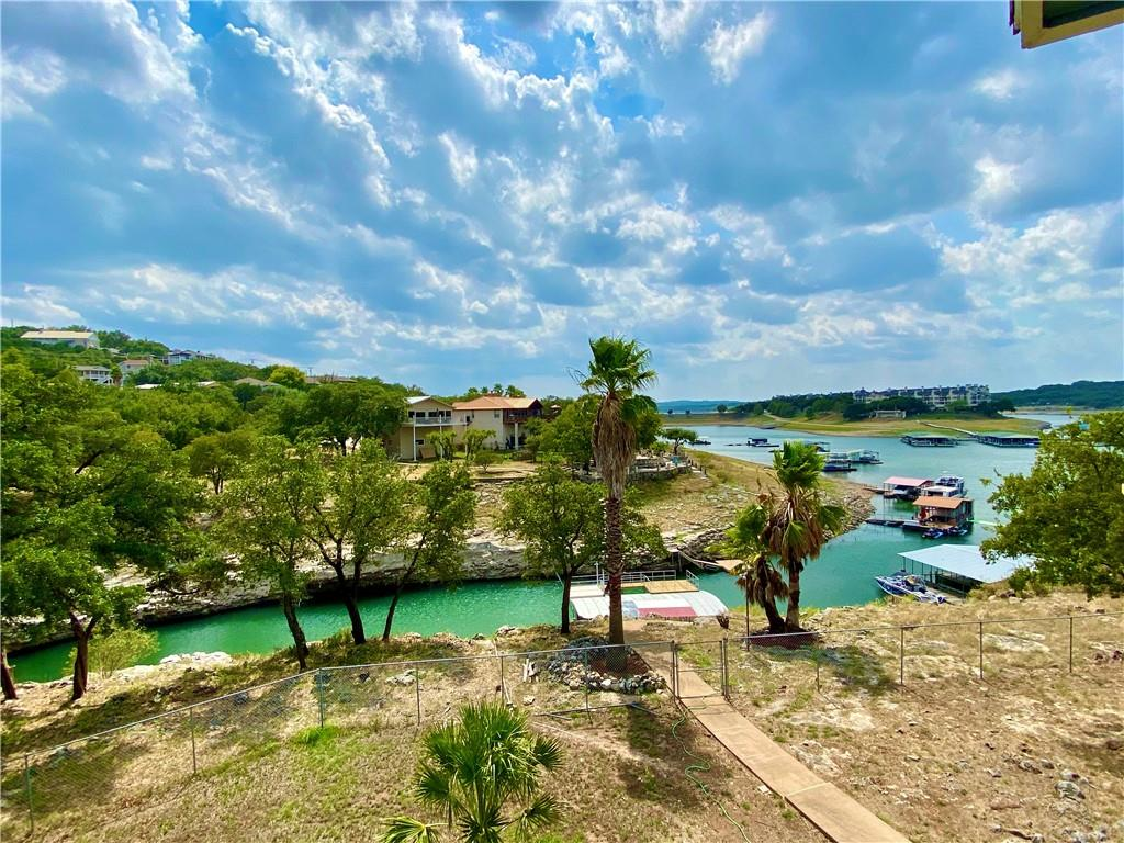 Lake Living at it's finest! Can be an income producing investment or your personal home. Furnished. 3/4 bedrooms, 2 baths, office, 3 living areas (game room), and expansive decks on 2 levels overlooking Lake Travis. Boat Dock. Circular driveway with ample space for cars and RV. Don't miss out on this gem!