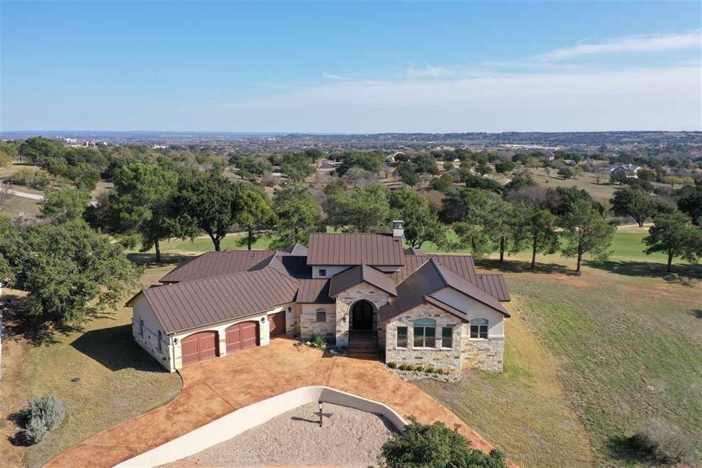 Breathtaking comes to mind when you see the views from this beautiful golf course home on a hill overlooking #7 Ram Rock with panoramic views of the Hill country! A great floor plan with an expansive great room; with floor to ceiling fireplace, gourmet kitchen, living, & dining. Large den and study along with a well equipped bar with wine fridge & icemaker! Each bedroom has it's own bathroom for family and guests. Wonderful outdoor living with large covered patio, fireplace, kitchen with fenced-in-yard! Oversized 2car garage with separate golf cart entrance. A nice sized mud room coming in from the garage with a 1/2 bath just off the kitchen. Come see this masterpiece!