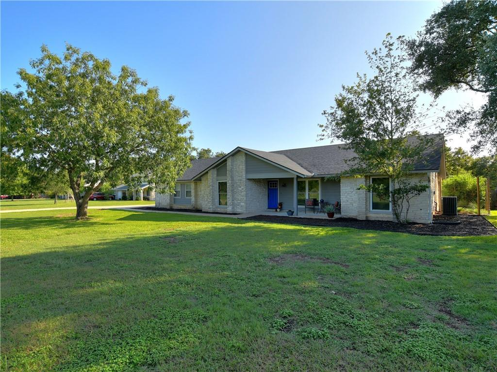 This is the home you have been waiting for. Recently updated Texas limestone ranch on one plus acre just minutes from I-35, Ronald Regan, MoPac and the new Indigo Ridge project. Well cared for home w/wonderful updates in a quiet Brushy Creek neighborhood with a private backyard. Split bedroom layout with hardwood floors/tile throughout and reclaimed barnwood accents. Wide-open cooks kitchen w/stainless appliances, pull-out shelving, soft-close doors and drawers, and beautiful custom backsplash. Open family room w/FP, offering unobstructed views out the back. Large bedrooms, especially master with fully remodeled ensuite with walk in wardrobe closet. Large laundry room with exceptional storage space. Attached 2 car garage for loading and unloading kids/groceries and extra parking in the 1,800 sq/ft 3 car detached garage with workshop area. Professionally landscaped courtyard surrounds sprawling outside covered patio complete with ceiling fan. This very family friendly home won't last long.