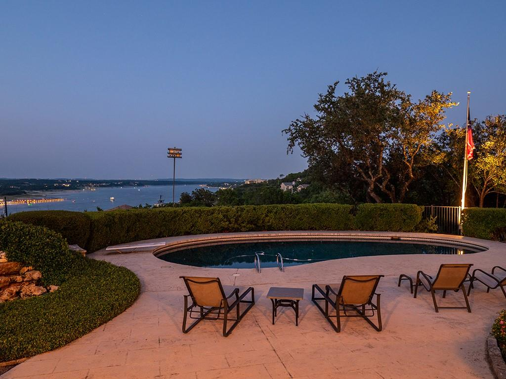 Lakeway resort lifestyle meets ultimate privacy with breathtaking  and expansive Lake Travis views.  This outdoor living dream on a quiet cul-de-sac lot is right in the heart of award-winning Lake Travis ISD.  Come home to a single level spacious 5,487 square foot estate sitting on .71 acres.  From the moment entering through the double wide glass doors, the lake view jumps out and visible throughout the property.  Enjoy entertaining in the double living room, fully stocked wet bar with wine fridge and ice machine, and cooking in the chef's kitchen with oversized refrigerator and freezer.  Imagine a spacious and comfortable master suite with a large sitting area, his and her bathrooms as his offers a steam room and hers a jacuzzi tub.  With two dedicated large en-suite bedrooms and a cozy office/tv room, family and friends have their spaces to spread out and relax.  Along with the outdoor kitchen and expansive covered patio for dining and lounging, gaze onto the lake from the sparkling pool and sun deck.  Welcome home to this unique single story home with all the character overlooking big views of Lake Travis!