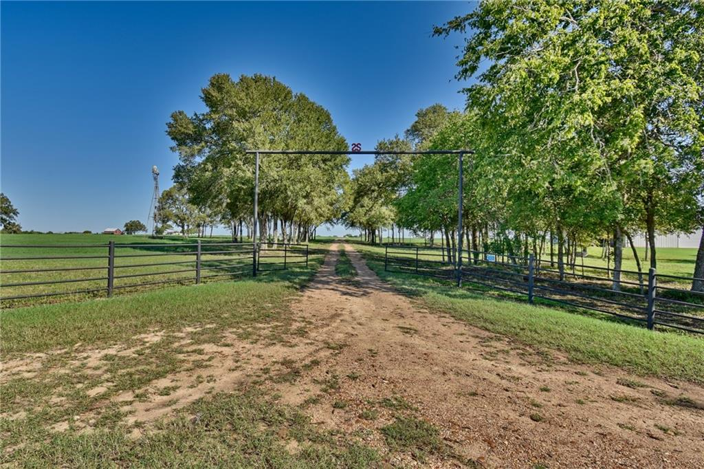 This beautiful 81.49 acre property is located North of Interstate 10 in Schulenburg. Easy access to Houston and San Antonio. It is part of the 2S Ranch & 2S Clydesdales. The land has pastoral views and a lush pasture of Kleingrass and Jiggs Bermuda. The 2 bedroom 1 bath house was built in 1903. It is waiting for some creativity and restoration. Wonderful antique red barn with a loft and a 6,000 sq ft metal barn that can be used for equipment or turned into a Barndominium. The land has clusters of pecan and oak trees. There is a windmill with an old hand dug water well near the entrance and the 5 wire fence is in excellent condition with metal braces and gates around the perimeter of the property. The property has some restrictions.