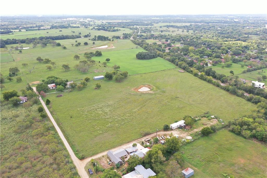 MFB Real Estate Services, Invites you to explore this Exceptional 63.20 Acre Elgin Ranch Available For Sale. This beautiful Ranch offers endless amenities, including but not limited to Mature Pecan Trees, Fertile Sandy Loam Soils - Coastal Grasses, Stock Tanks perfect for Cattle Grazing along with a lovely Farm House. This property is also located minutes away from Major Highway Corridors of which makes this Property a great possible Transitional Use - Redevelopment Investment Opportunity. Contact us today to learn more.