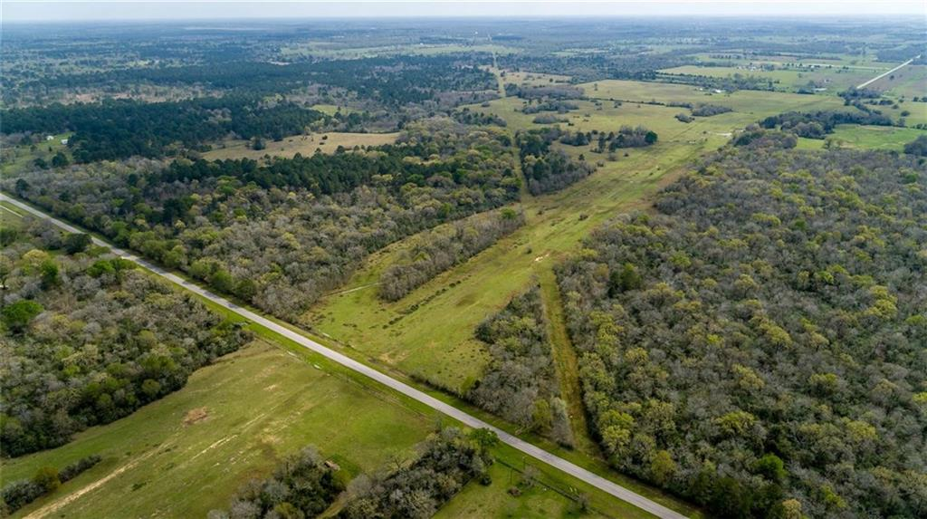 """641+/- acres of prime Waller County recreational investment land. The largest unimproved tract in Waller County currently on the market has minimal floodplain and no restrictions. A beautiful mix of improved pasture and native woodland, this diverse ranch could be used for development, a large ranch homestead, a weekend getaway, or a full-scale retreat. With over 6,700' of frontage, this property has development potential and could take advantage of the 8"""" G&W Water Supply Corporation's waterline along the north side of Reid's Prairie Road."""