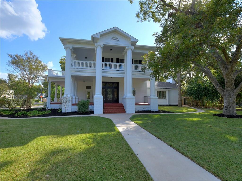Call/Text Agent for appointment - MUST BE PRE QUALIFIED BUYER.  Historical Neoclassical Revival Beauty combined with todays comforts.   Originally the Booty house built 1889 for A.A. Booty the founder of Texaco.  This home was lost to fire in 2006 and was rebuilt in 2009 to replicate the historical details of the original home.  This home offers 4 Bedroom, 4.5 baths. (3 bedrooms w/ensuite baths), 3 fireplaces.  Amazing balaconies and wrap around porches.  Located on .66 of city block in Old Town.  New roof in 2018 and solar panels in 2018, 2018 Acorn stairlift conveys, 2016 water softener, 2017 water filtration, skylights, solar tubes, tankless hot water heater, cent. vac, full sprinkers and gutters, 2020 new exterior and interior paint.  This home offers all the details of an historical home with the benefits of a home built in 2009.   Don't miss out on this opportunity.