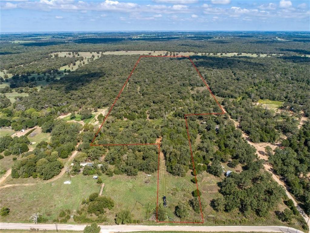 A secluded recreational property that is covered with mature Post Oaks and Eastern Red Cedar.  The closed canopy forest and wet weather creek serve as wildlife magnet for deer and hogs.  This property is a blank canvas ready for you to make your own wildlife mecca.  Easily accessed off Hwy 290, while only 20 minutes from Elgin and Lexington, and under an hour to Austin. The 50 acres is primarily a closed canopy woodland with mixture of open areas and senderos. A tributary to the Middle Yegua Creek along with its dense canopy cover and underbrush serve tremendous travel corridor for wildlife such as Whitetail Deer and feral hogs, both of which have been observed on the property. The owner's family and friends have hunted deer on the property and report good numbers and quality bucks for the area.   A tributary of Middle Yegua creek crosses through the property and has a few pools of water even in dry conditions.  The property is perimeter fenced with the fencing being in good condition.  Electricity is available at the frontage from Bluebonnet Electric Co-op.  Rural water is available along the frontage from Aqua Water, but there is no meter currently. Water wells in the area are around 400' and produce anywhere from 30-50gpm. Most of the needs of a landowner can be found less than 20 minutes away in Elgin.  Major retailers such as HEB, Walmart, and Tractor Supply are just a few located in Elgin.