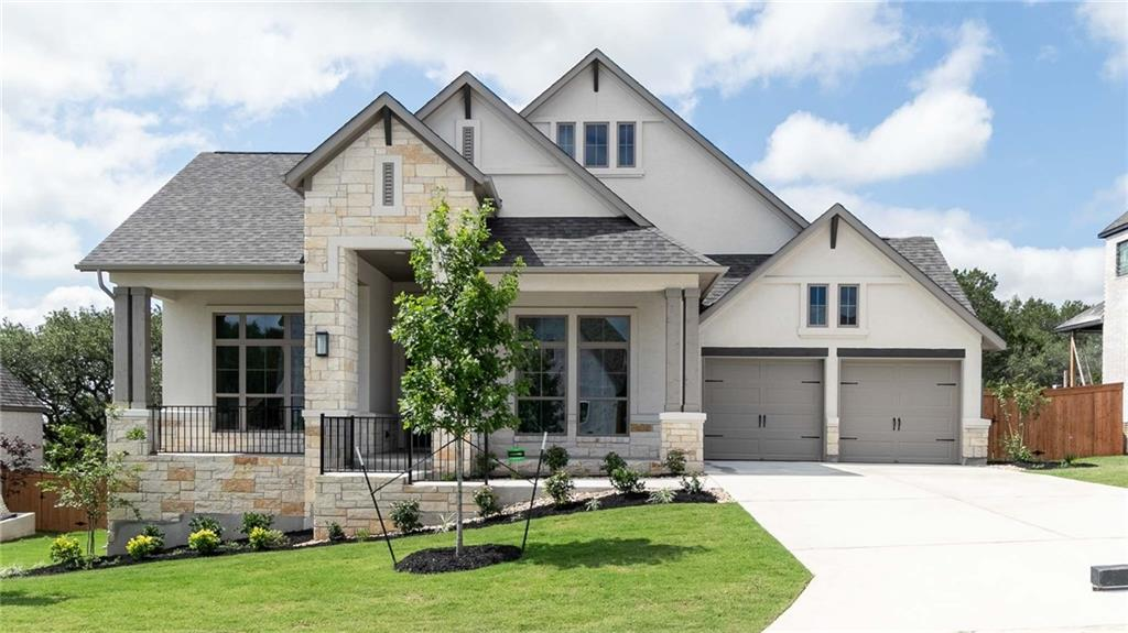 Entry with 12-foot ceiling leads to open kitchen, dining area and family room with 16-foot ceilings throughout. Kitchen features Butler's pantry, walk-in pantry and island with built-in seating space. Dining area leads to family room with a wood mantel fireplace and a wall of windows. Primary bedroom features 13-foot ceiling and wall of windows. Primary bath includes dual vanities, garden tub, separate glass-enclosed shower and two walk-in closets, one with access to utility room. Home office with French doors features 12-foot ceiling and wall of windows. Game room features 13-foot ceiling, wall of windows and storage closet. A Hollywood bath and guest suite with private bath add to this generous design. Covered backyard patio. Mud room off three-car garage.