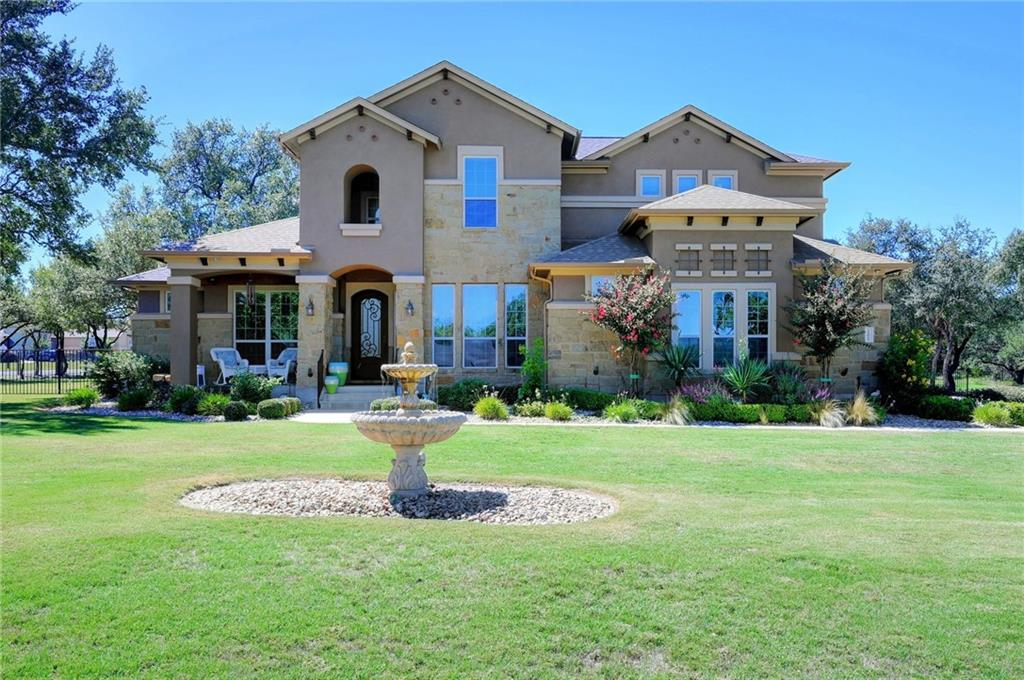 Enter the one-acre plus community and be greeted by the lovely mature seasonal landscaping and peaceful waterfall upon entry. Pass the playground and drive over the community creek to arrive at this stately home highlighted with a well-manicured lawn, mature trees and a peaceful water fountain. Enjoy the front covered porch during evenings and wave to neighbors that pass by on their golf carts out for an evening stroll. Upon entering this exquisite home, be greeted with a grand foyer, double-crown molding, private office and perfect music to set the ambiance of pure relaxation. Continue into the great room, open to the expansive kitchen equipped with double ovens, oversized fridge, under/over cabinetry lighting, upgraded granite and glazed cabinetry. Enjoy a walk-in pantry, drop station for keys/purses off the garage entry into the home, and a bonus/recipe room! Feel the positive energy as natural sunlight beams through the expansive floor-to-ceiling windows. Entertain in the dining room just off the main living room furnished with the extended glazed cabinetry which serves as the perfect buffet/dry bar space for entertaining! Walk through the private hallway to the master bedroom boasting his and her closets, frameless glass rain shower, tub, extended cabinetry and vanity finishes. Secondary bedrooms, most located on the main floor, are found in the opposite side of the home with oversized vanities and linen closets. Storage does not lack! Walk upstairs to the game/flex room, a space suited for an enjoyable evening of games, movies, and additional guest quarters. Oversized laundry room with additional cabinetry for storage, fence, blinds, gutters, newly installed pergola, extended patio, outdoor kitchen and more in this newer-build community! Plenty of room for a pool retreat!