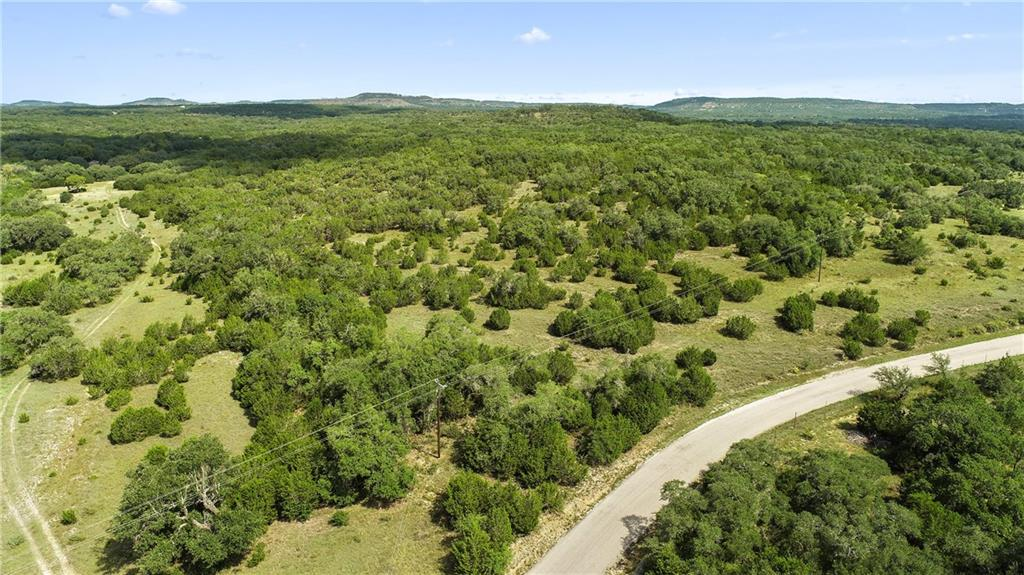 160 +/- Acres in a phenomenal location!!!!  This ranch offers over 2500 feet of paved road frontage on Red Corral Ranch rd.   Nestled in the country just outside the Booming towns of Wimberley and Blanco, this amazing property has it all! Gorgeous views, beautiful trees, nice topography, excellent building sites and great location with easy access.  Tracts like this do not come along very often.  Located under an hour from both Austin/San Antonio and minutes from San Marcos, New Braunfels, and Dripping Springs. Must See!