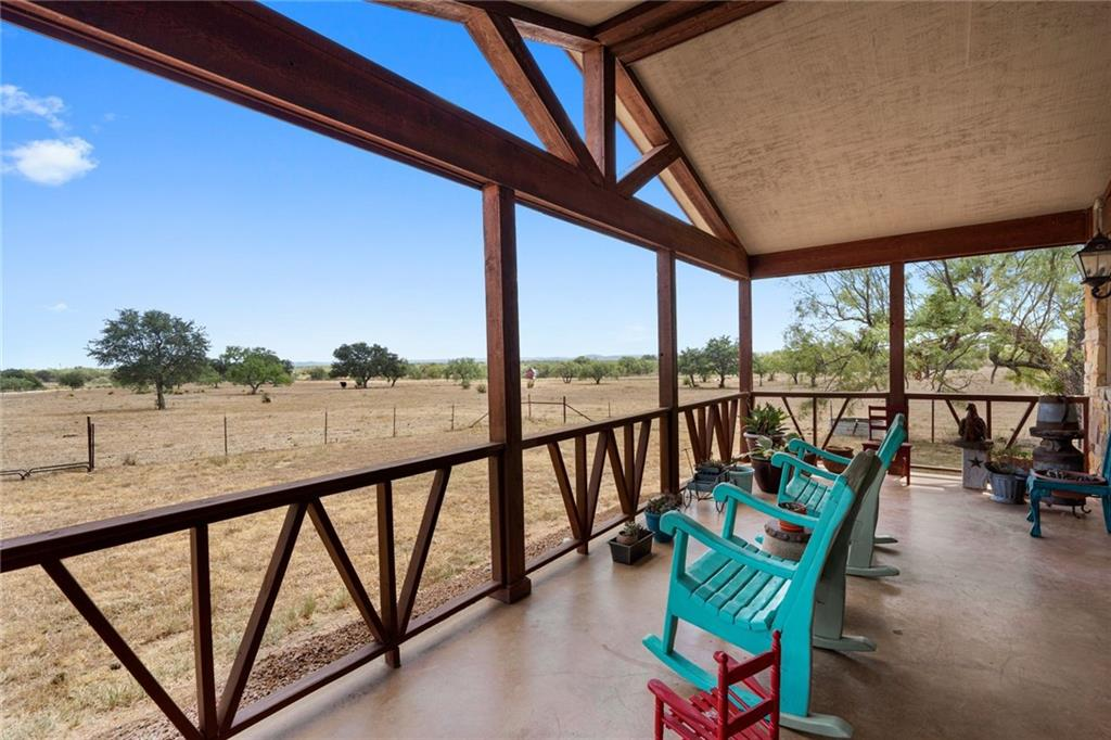 Gentlemen's ranch and custom built ranch house overlooking the Texas Hill Country!  Beautifully designed open floor plan with stained concrete floors and rustic touches. Living area open to kitchen features a fabulous chandelier and wood-burning stove. Custom cabinetry in the kitchen with gorgeous granite countertops. 3 bedrooms plus a study that could easily be a fourth bedroom.  Large one bedroom guest house with huge living area and kitchen.  Currently used as a cattle operation but could be used for horses.  Large covered patio as well as a picturesque front porch.  Perimeter fenced and cross-fenced.  Well and septic. Currently used as cattle operation for ag exemption.