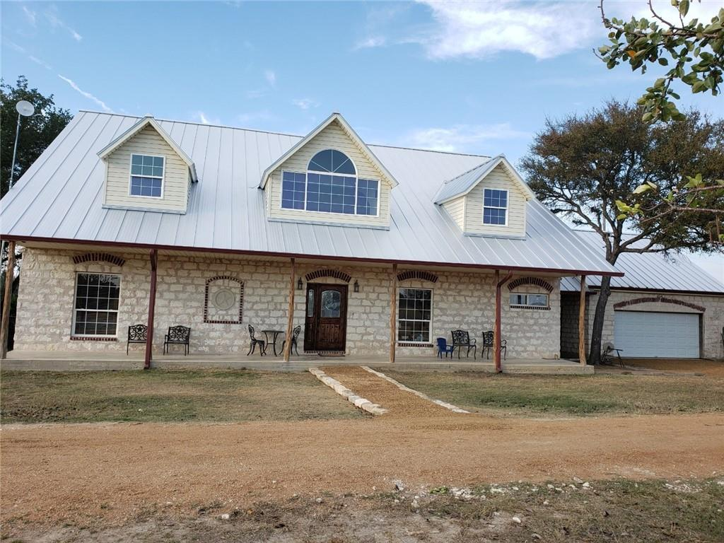 """Country living at its finest on this tranquil 6.237 acre tract, agriculture exempt with gorgeous trees including pecan and fruit bearing.  This beautiful custom 4 bdr, 3-1/2 bath home hosts many custom features including ceiling beams of long leaf pine and reclaimed bead board throughout. Second floor has recently been rough finished and ready to add your personal flare of paint and flooring.  New standing seam, galvalume metal roof installed and guttered in 2019. Enjoy more consistent temperature comfort and lower utility bills with this well insulated home. Exterior walls feature 5-1/2"""" steam injected styro embedded with metal studs for R46 factor; roof construction composed of metal frame with 2'x42' seamless panels of urethane reinforced with steal skins on top and bottom for R54 factor.  Detached 800 sf 2 car garage, hosts nice work area with 2nd floor loft."""