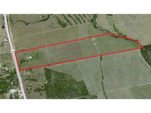 """Less than 14 minutes from the new Tesla site on 130, this is a Developer's Dream! This 86.70 acre tract is partially in the City of Lockhart and partially in the ETJ of the City. Fully fenced and with an Ag Exemption, this tract is immediately available for a large box or commercial application. Falls within the City's approved commercial zone and is available along with the adjoining tract for a mixed use or commercial application of over 125 acres with over 1500 ft of SH 183 Frontage.  12"""" water line and electricity available at the front of property."""