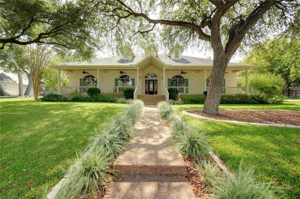 "This immaculate home nestled in Oak Bluff Estates is perfect for golf course community living. The front yard was voted HOA's September 2020 ""Yard of the Month"" and no wonder ~ the vibrant landscaping is well-established, with mature shade trees and full irrigation. Relax on the covered veranda with a cup of ice tea on a warm summer day or hang out on the back patio and watch the kids romp around in the afternoon shade ~ either way, this half-acre lot is designed to be enjoyed. The inside of this 4 bed/3.5 bath custom built ranch style home delights the eye in every room ~ enter into the spacious foyer and be awed by its high tray ceiling and chandelier ~ wander into the formal living and look out the large window centered between matching built-in cabinets with display shelves ~ continue under one of the home's many arches into the formal dining room and marvel at its natural wood built-in china cabinet ~ behind french doors, you will find the 4th bedroom or office with built-in desk, cabinetry and amazing wainscoting ~ the great room centers around a beautiful gas fireplace and built-ins on either side of entertainment wall ~ the gourmet kitchen is wide open to the great room and breakfast area and it features ss appliances, center island, an expansive breakfast bar, large pantry and ample cabinetry ~ the utility room offers built-in cabinetry with large sink ~ the 3 spacious bedrooms all enjoy en suite bathrooms ~ the master bath sports double vanities, separate shower and soak tub, and a large walk-in closet ~ the master bedroom itself has access to the expansive back patio ~ throughout the entire home you will find custom paint and hardwood floors with hard tile in the utility and bathrooms ~ the attached garage has 3 bays with the 3rd bay being oversized at 25 ft deep ~ with all its wonderful features, this haven is sure to please for years to come!"