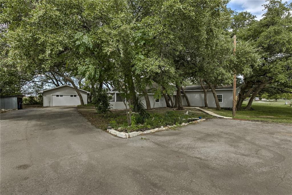 This home has been painted inside and out.  New flooring.  New tile in master bathroom.  New hot water heater.  Recent A/C units.  Nearly every area of this home has been redone.  Must see to believe.  The garage is a four car tandem parking.
