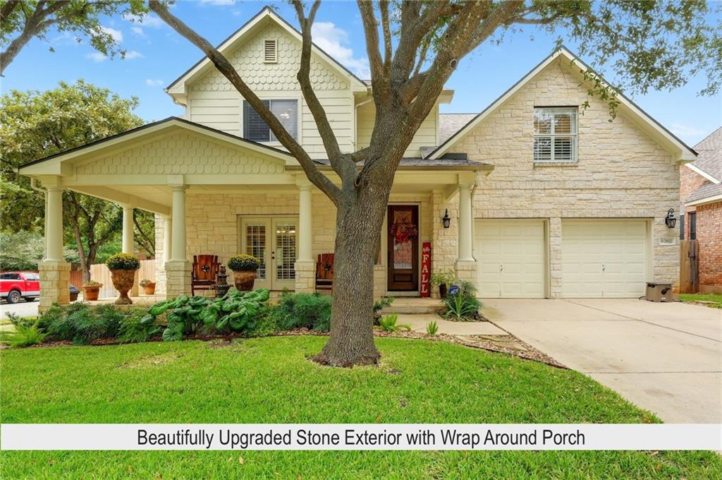 This beautiful home with mature trees and upgraded stone exterior perfectly compliments this corner cul-de-sac street location. A wrap around covered porch also adds a beautiful look to this front elevation. Upon entering, you will notice soaring ceilings at the entry and family room as well as wide-plank hardwood flooring that is carried throughout the downstairs at all of the non-wet areas. This 5 bedroom, 4 bath home features a master and secondary bedroom down with two very updated baths. Upstairs you will find a game room and 3 spacious bedrooms with two baths (one is Jack/Jill). Other elegant upgrades include plantation shutters at ALL windows, high-end KitchenAid stainless appliances (including double ovens), recent roof, recent paint and even a wrap around rear patio as well. Be sure to see the list of updates/upgrades. Enjoy phenomenal Behrens Ranch amenities, the best schools in Round Rock and low City taxes (No MUD tax).  Perfectly located between Cactus Ranch elementary and Walsh middle schools - a short walk to each.