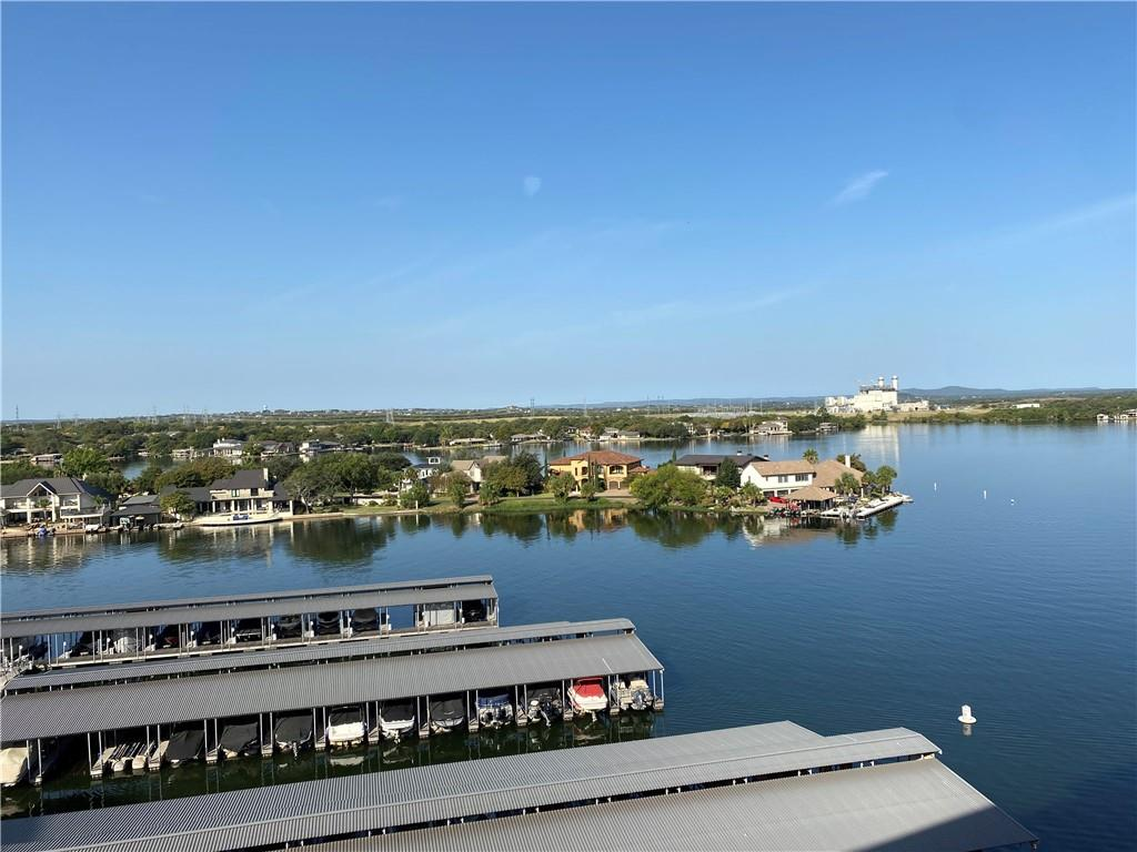 Amazing views of Lake LBJ and Hill Country from top floor of midrise Condominium. Open and flexible from plan with extra large covered porch overlooking lake and marina. Hard to find 3/2 on top floor and can be VRBO.