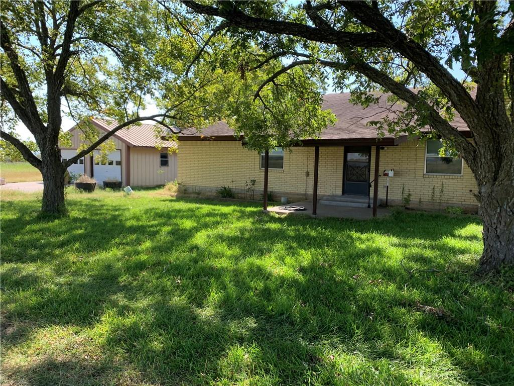 LOCATION, LOCATION, LOCATION.  Home and land available for the first time in over 60 years.  Beautiful views, AG exempt land. Convenient to everything. Home on property or build your dream home.  3 outbuildings/barns. 87.69 total acres!  Large mature pecan trees.