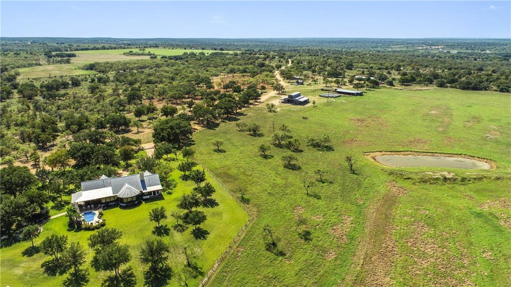 A true Texas Legacy Ranch, 2,582 acres, border by the Colorado River, offering the finest in improved pastures, native game habitat and high-quality improvements. It can be reached in 15 minutes by State FM 500, just north of the quite town of San Saba.  Fenced and cross fenced with seven strand barb wire, one can easily manage stock rotation between the improved grass pastures.  A large portion of the ranch is covered in native brush and vegetation, perfectly suited for deer, turkey and hogs.  Blessed with many fine water features, the Colorado River (with irrigation rights), two creeks and a number of stock tanks are scattered throughout the ranch, offering exceptional bird shooting and fishing opportunities.  