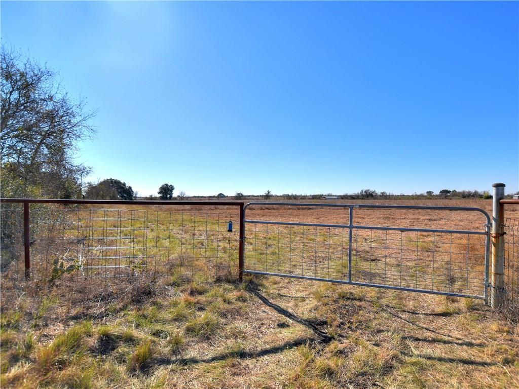Fully fenced Level Large 12 acre lot on Hwy 183 in the center of Briggs!  Good frontage and flat building site for future retail/mixed use. Only county building permit currently needed for this unincorporated city.  Located in the center of  Briggs at Junction of Hwy 183 at loop 308/ road 2657. This  intersection is at a slow down point of 183 and may have a traffic light there in the near future.  Also near  Briggs gas station, post office, and Firefly Aerospace. Incredible  Great Investment opportunity to develop or hold as investment. Currently holds Ag Exemption. First Station being built 3/4 mile South. Incredible Opportunity.