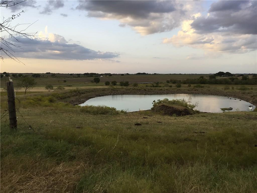 Beautiful 140.50 (-) acre ranch, located 11 miles east of Taylor, TX. 5 minutes away from Granger Lake. Possibilities are endless with this property. NO restrictions!! This property includes: 6,459 feet of road frontage, 6 stock ponds, 2 water wells with pumps, 2 wells without pumps, 2 water meters and one reserved meter from Southwest Milam, 40x40 metal building, and 40x70 metal shed. Pecan Creek runs through partial of the property. Panoramic view!! If you seek county living, look no further. Gorgeous sunsets that Texans always rave about. This property can be subdivided or can be left whole. Three tracts include: 89.24 acres, 41.26 acres and 10 acres.