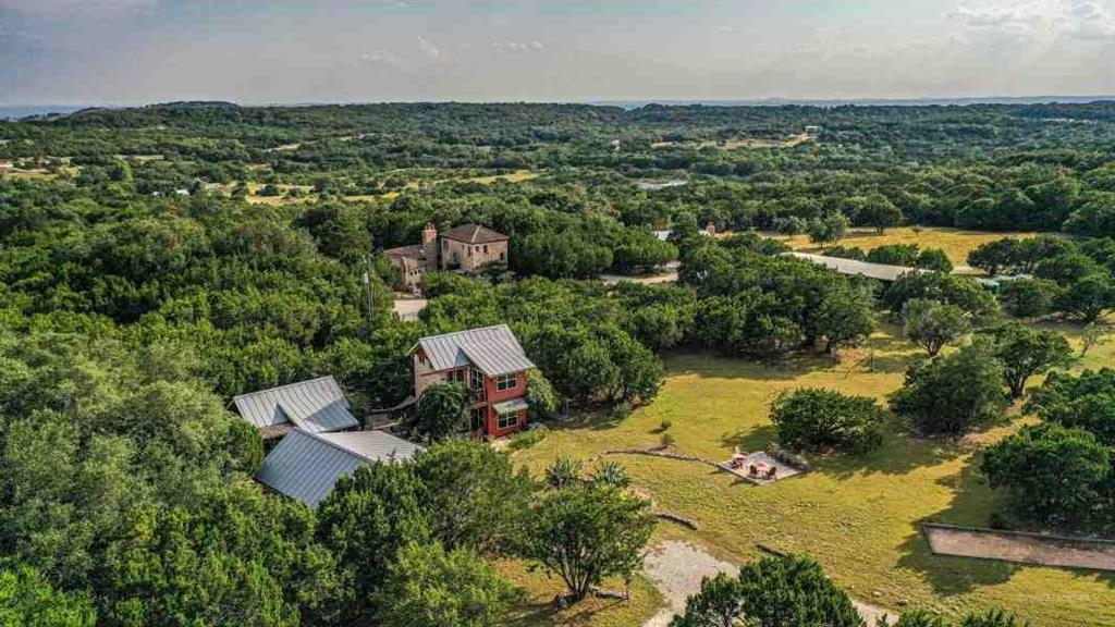 Juniper Hills Farm & Onion Creek Kitchen is one of the finer destination properties in Central Texas. Located a short drive to Dripping Springs, Austin or Fredericksburg, this property is an attractive option for buyers in the heart of the wedding and wine capitals of Texas. Ideally situated as a self-contained family retreat, luxurious corporate destination property, or an income producing venture. Juniper Hills Farm has been featured in Texas Monthly, Southern Living, Better Homes and Gardens and Texas Highways. The main house, commercial kitchen, pavilion, pool area, spa, and four casitas were custom built with great character, and the acreage is Wildlife exempt for affordable property taxes.