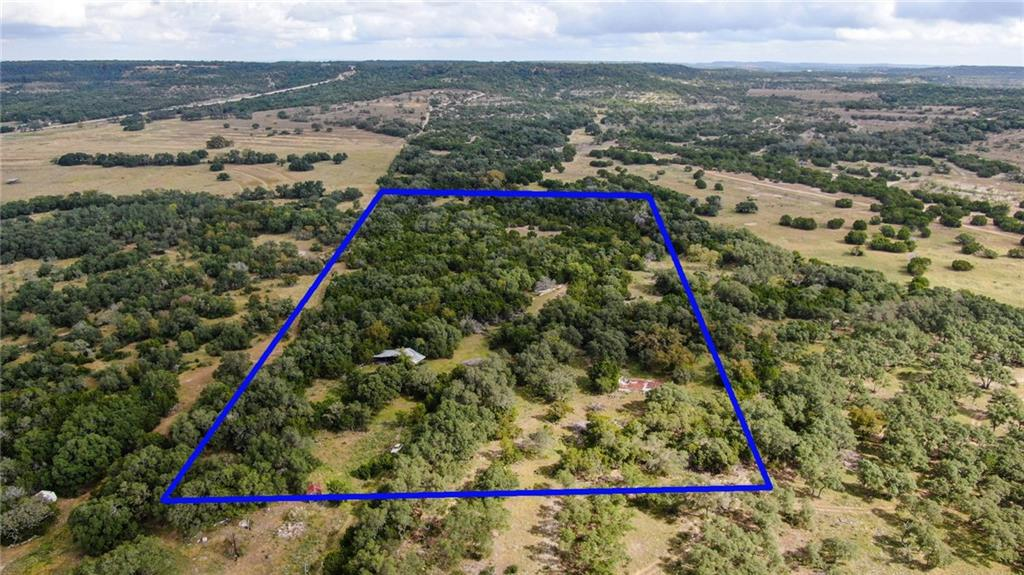 Unrestricted 15 acres centrally located between Blanco and Wimberly on RR 2325. Private and peaceful homesite surrounded with mature Oaks and abundant wildlife. Property features 3 rustic structures with a lot of character and beautiful distant Hill Country Views. 