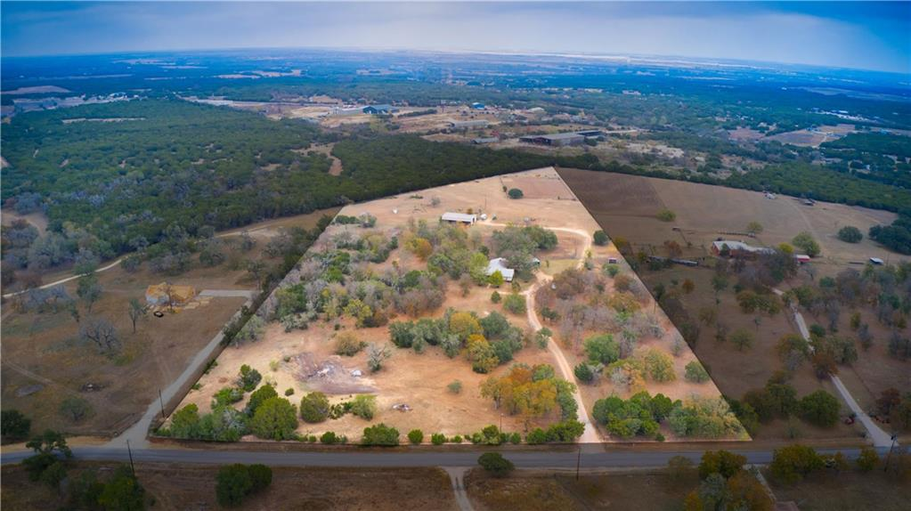 "15.43 ac, AG EXEMPT horse property with a ""rock solid"" 3 bd, 3 full bath home in Liberty Hill, Burnet County. Fantastic location, 7 minutes to Hwy 29 & CR 200 in Liberty Hill, 18 minutes to Hwy 29 & 281 in Burnet. The topo is mostly level and is roughly 60% heavily wooded and has the perfect amount of open pasture for livestock. Barn has 5 stalls, hay storage, auto water and a combo feed/tack room. Just outside the barn is a hot walker and wash rack. The back corner of the property has a 160'x210' arena, constructed from panels. Near the home is an equipment shed and a loafing shed in a separate paddock. A stock pond at the front of property needs work and does not hold water very well. The exterior walls of this sturdy home is constructed of concrete block and stone. Home has some nice interior stone work and a gas log fire place. The floorplan is desirable and would work great with some updated finishes. Solar powered gate is opened by keypads. Home is 100% electric and water is provided by a well. The deed restrictions are very minimal: no junk yard, no wrecking yard, or mobile home park. In Burnet ISD, however, per seller, out of district students can transfer to Liberty Hill ISD. An incredible all around property in a very desirable location!"