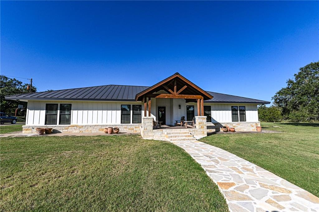 The location of the Kimbro House unsurpassed in the Kyle & Buda area. The home sits on 10 acres just one mile form Hays High School, at the end of a private drive with exceptional privacy, gated access and a remote ranch feel. The 3,024 sqft home has 4 bedrooms, 3 baths and an open floorplan with a modern kitchen. The exterior was completely remodeled in 2019 with new Pella windows, standing seam roof, stone veneer, board and batten siding, and front porch with exposed timbers. The home is surrounded by a huge yard with large mature live oaks and room for livestock or horses. Perfect for the commuting professional or family looking for room to spread out. Seller is willing to offer a credit for flooring and bathroom remodel. The property is a 10 acre tract (Lot 5) in Century Acres subdivision. Approximately 4 acres inside the yard fence in manicured and mowed, offering an exceptionally large and beautiful lawn. The remaining +-6 acres outside the yard fence is native brush and habitat for wildlife. This could also be used for grazing livestock. Inside the yard are more than 15 large mature Live oak trees. The property is gated for privacy, and a second gate was recently added for a future guest house. There are a total of eight ranch lots in Century Acres. Century Acres has moderate restrictions to protect property values and privacy.
