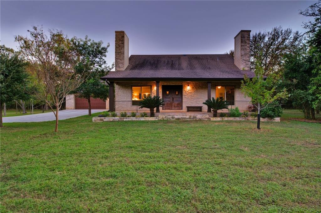 Hidden in Sunset Valley, this gated 4.38 acre tract of land offers opportunities for peaceful, private family living in a way that few other properties in Austin can. Buffeted on two sides by greenbelt and with easy access to the Sunset Valley trail system right out the back gate on the third side, this home and the invaluable land that surrounds it, provides a unique experience in the heart of Austin. There is plenty of space for domesticated wildlife like horses, goats and chickens to be comfortably housed on property, and the native plants and animals that adorn the land supply endless amounts of enjoyment and beauty all year long. The large, fenced-in raised bed vegetable garden and the wet-weather creek that meanders through the grounds provide even more reason to cherish this legacy property for generations to come. With an open family room and an eat-in kitchen with a door that open to the pool, waterfall, and covered patio space, this home continues to provide special amenities for experiencing natural, peaceful luxury. The owner's suite is spacious, with plenty of room for a private living area or home office, and French doors that lead to the pool. An additional downstairs bedroom and bathroom offer flexibility for family and guests, while the upstairs bedroom and bath are flanked by a cozy loft, a perfect retreat at the end of a long day. An unexpected bonus is the nearly 500 square-foot air-conditioned garage apartment, roughed out for a kitchen and bath, and ready for to be finished to the owner's liking. The garage has higher grade power for workshop tools and equipment and plenty of space for all your hobbies. Everything about this property is special. From the secluded setting among native Live Oaks to the sprawling land and welcoming family home, to the unexpected proximity to schools and businesses, opportunities for a life well-lived are never-ending.