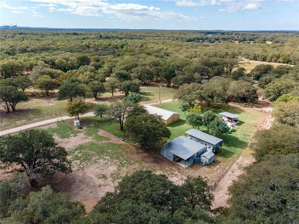 """46 acres for sale! Calling all Hunters! Here's the  Heavenly Dream place in Central Texas! Plenty of wildlife & deer to hunt! Wait until to see the Game Wall to prove it!Tucked away with privacy and beautiful country scenery less than an hour from Austin and College Station.Cute 3 bedroom, 2 bath Barndominium style home with a new inground pool and cabana covered patio perfect for entertaining & grilling for a party. There is RV covered parking, Shop building 40 X 30 with an insulated """"mancave"""" that is 14 X 15 with AC! Bring your 4H livestock to the 40 X 40 Barn with 2 separate fenced pastures. A tank to go fishing with friends and perfect spot for dove hunting!"""