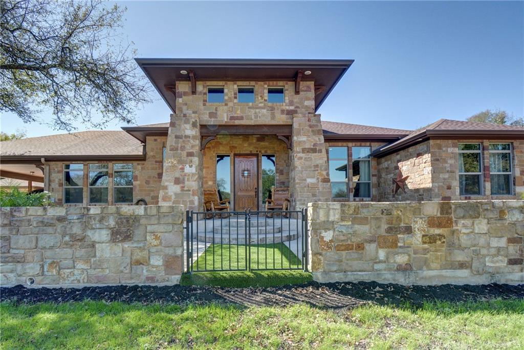 Every detail of this Craftsman inspired custom estate was planned to take in the views of a registered 22' circumference 400 year old Live Oak in the front pasture. Wrapped in multi-color limestone, with oversized windows and all high-end finishes this estate has abundant features including a giant barn/guest home, matching rock 2 car garage. The home is fully spray foam insulation for comfort. Offering large scale exterior areas for entertaining. This enclave of 15 acreage homesites is Restricted to retain the beauty and allure of quiet country living yet being less than 10 minutes from town. No details were overlooked from the gorgeous super-sized kitchen island to the many closets. Gourmet kitchen with commercial appliances and custom cabinetry. The floor plan and window placement offer great flow and incredible views from every window. Access to the estate is via a private asphalt road thru the private subdivision. Stone columns and  an automatic iron gate lead you up a concrete driveway thru the manicured pasture to the homes. Of the 26 acres about 2/3 is native forest. Currently Ag exempt, the sandy loam is great for cattle but could also make a great equine facility. Main house is 2500'. Guest house is 800'of heated and cooled space, remainder is total building footage of 7500.