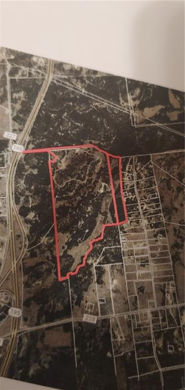 301 acres with older home . Heavely treed  . Hilly terrain with a creek . Some outbuildings . fenced and presently has cattle  . No leases
