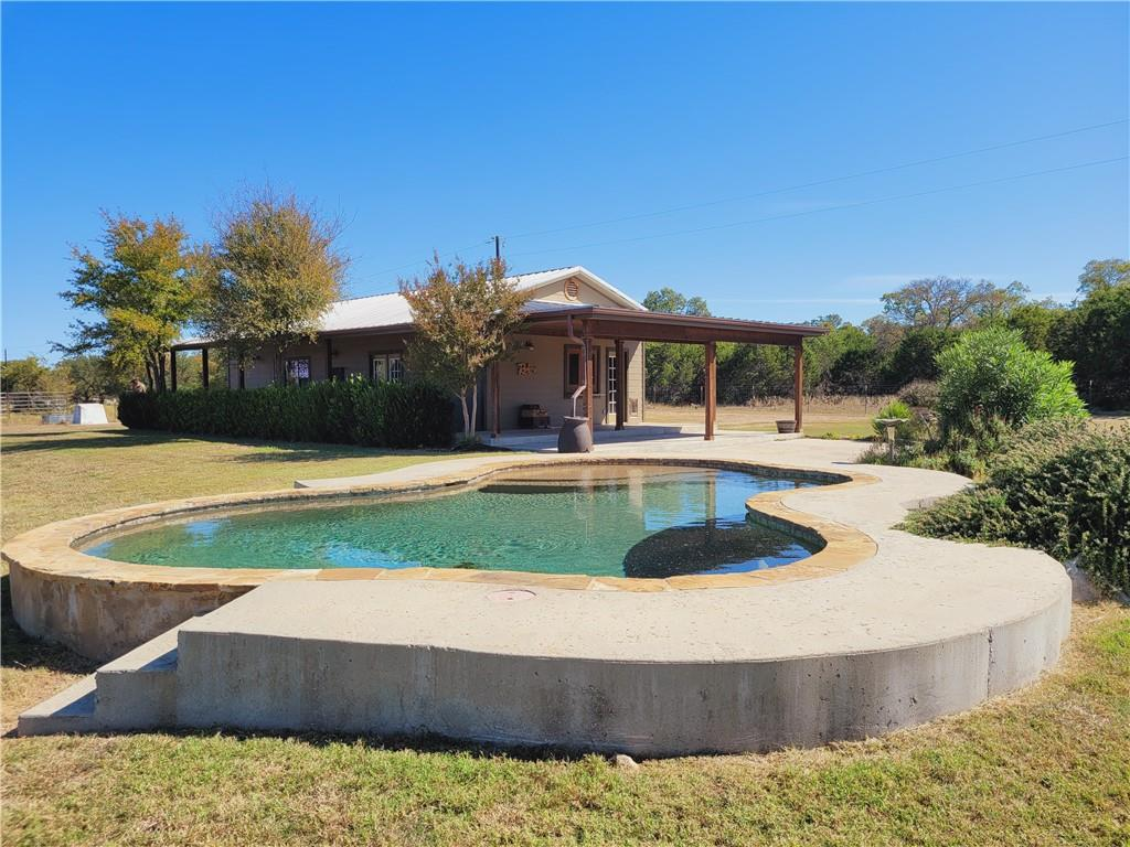 Off the beaten Path, SECLUDED.  Off the Grid.  Away from It all.  Out in the Boondocks but near Austin/Burnet/Bertram/ Marble Falls.  A little slice of heaven in Central Texas. Access through shared maintained road near OATMEAL, Texas.  A wonderfully finished pool house along with a super large barndominium..... Great investment property.  Up to 80 acres....You can buy the buildings and 11 acres...and lease the rest for 400k purchase price with $25 a year per acre on the remaining 68 acres