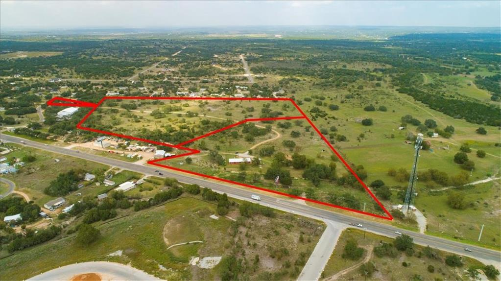 """Incredible opportunity to own unrestricted acreage in a highly sought after location surrounded by future development. 43.88+/- acres with approx. 1000' of State Highway 71 frontage between Spicewood and Marble Falls. TxDOT approved entrance on Hwy 71 with approved LCRA low water crossing/bridge. Second entrance on Parr Ave. is 100+/- ft off of Hwy 71. Improvements include 2956 sf office building, 2 (2 sided) Billboards, 2 water wells and (2) 3000 gallon storage tanks irrigate the garden and supply the office. 25,000 gallons of storm water harvesting tanks supply the office building. A 4"""" and 6"""" water line with meter exists on property for future use. 100% perimeter fence and cross fenced with agricultural tax exemption. Current developments nearby include,  240 acre Gregg Ranch comprising of 840 single and multi- fam residences and Thomas Ranch, an approved 2200 acre master planned community in Spicewood."""
