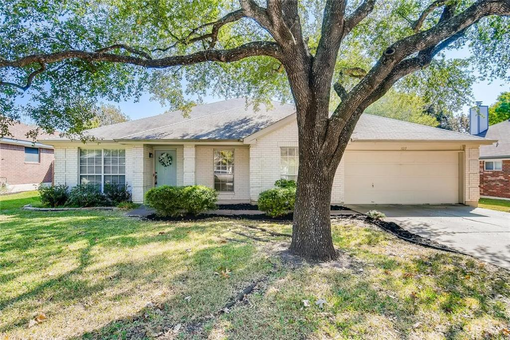 Adorable 4 bd / 2 ba single story home in a great Pflugerville neighborhood! This well-kept home features private wings for all bedrooms, high ceilings, an open floor plan, and a large backyard! Lush landscaping, a white brick exterior, covered front porch, and eggshell blue door adds great curb appeal, white crown molding, carpet flooring, and natural light create a warm and inviting interior. Formal living and dining rooms sit ahead of the foyer - perfect for entertaining! Up ahead is the kitchen, equipped with a center island, gas cooktop, white/grey cabinets, recessed/pendant lights, and bar seating! The kitchen is surrounded by a breakfast nook, with a crystal chandelier and access to the backyard, and a second living room, complete with a fireplace. Wind down in the primary suite, offering a bay window, two walk-in closets, two antique style vanities, a garden tub, walk-in glass door shower, and water closet! The three remaining bedrooms are generously sized and share the full hallway bath. Relax and customize the fenced-in backyard, made up of a raised patio, playset, and expansive lawn! Central A/C and Forced Air heating. Alarm. Two car garage with storage space. Located near community pools, Pflugerville park system/trails, shopping, and dining! Easy access to Rt. 130, I-35, and Austin. Buyer should verify all information including flood status.
